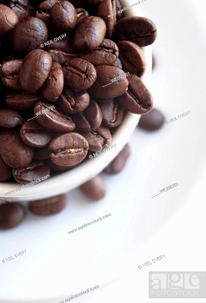 Stock Photo: Coffee beans and cup.