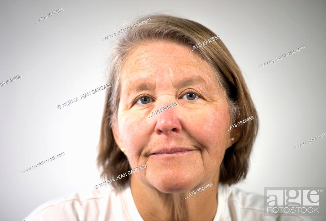 Stock Photo: A senior citizen female poses for a portrait.