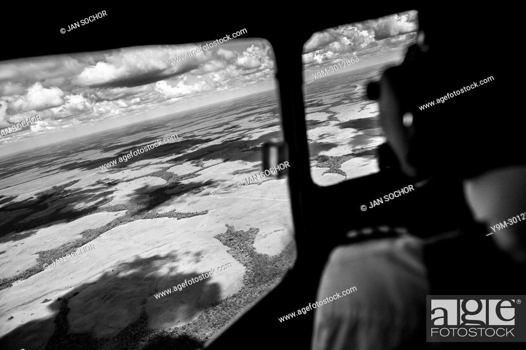 Stock Photo: Captain Claudio Petro, a Colombian airline pilot, flies a Douglas DC-3 aircraft above Los Llanos, the vast savannas in the remote department of Guainía.