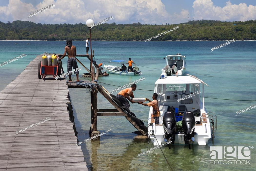Stock Photo: Loading Scuba Tanks on Diving Boat, Ambon, Moluccas, Indonesia.