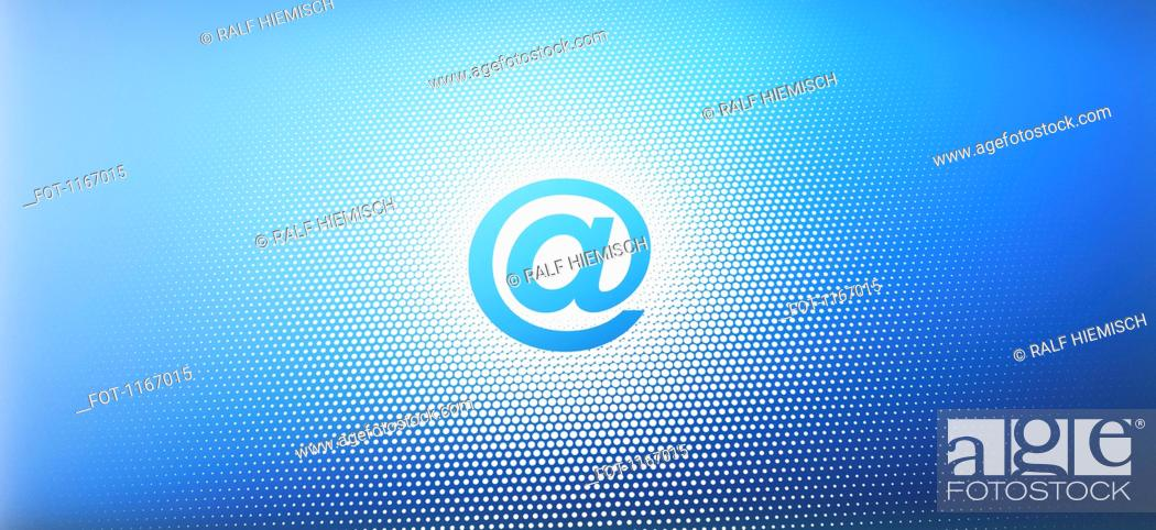 Stock Photo: At sign against an blue abstract background.