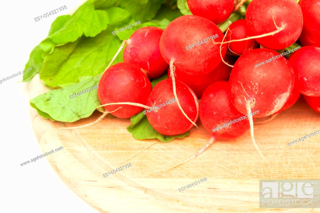 Stock Photo: bunch of radishes on wooden board.