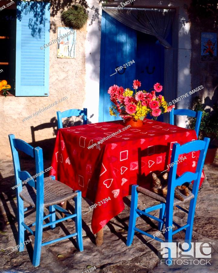 Stock Photo: Table and blue chairs - southern terrace.