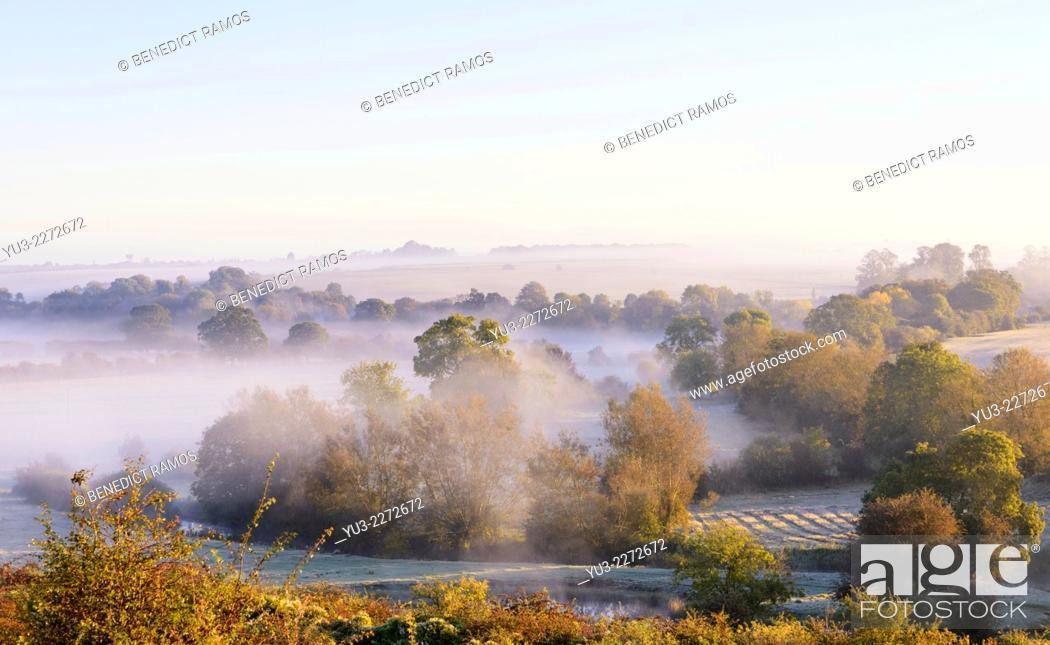 Stock Photo: Sun breaking through on a misty autumn morning at Northbrook in the Cherwell valley Oxfordshire England UK.