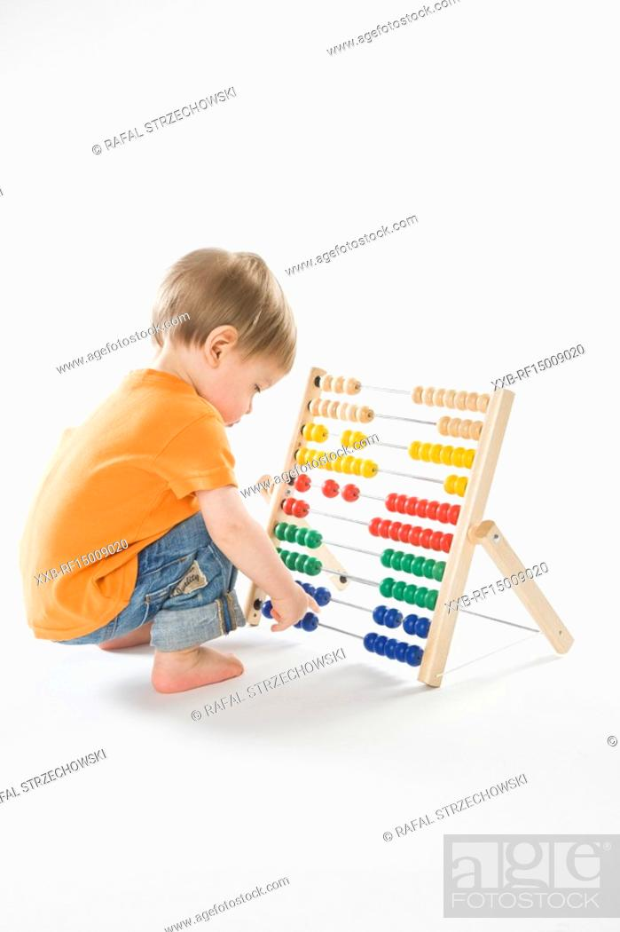 Stock Photo: baby playing with abacus.