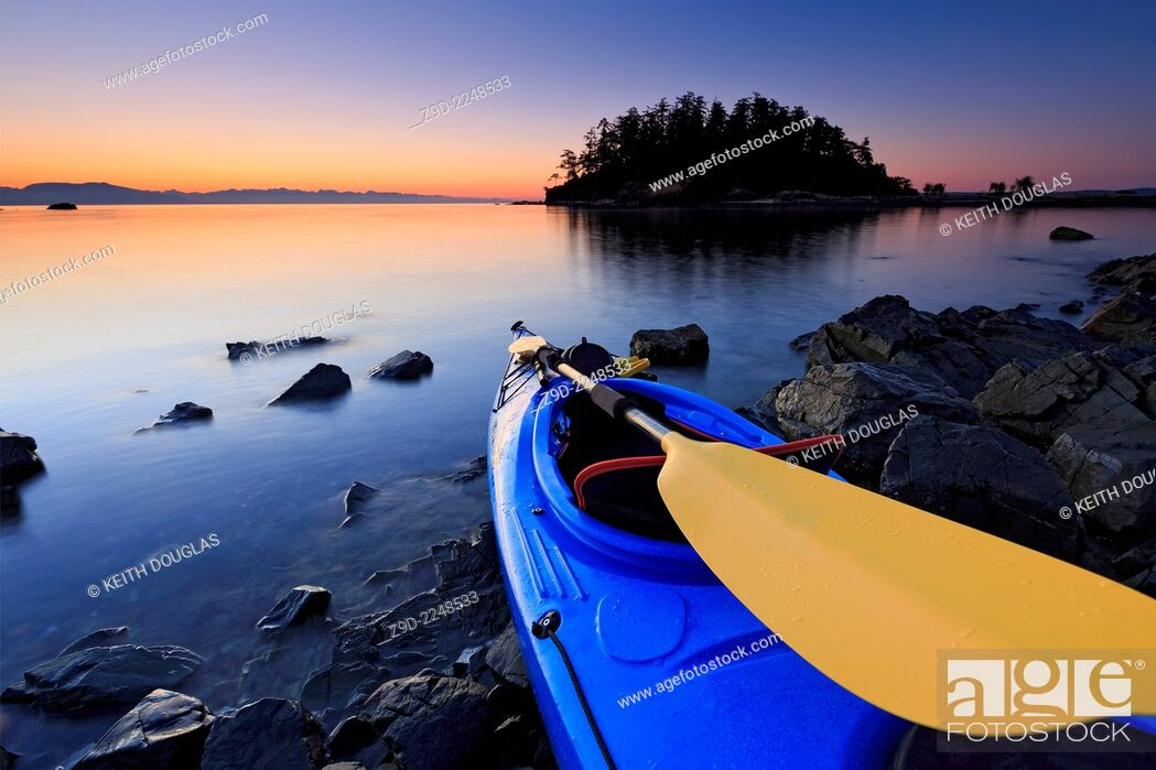 Stock Photo: Sea kayak scene at sunrise, Pipers Lagoon Park, Nanaimo, Vancouver Island, British Columbia.