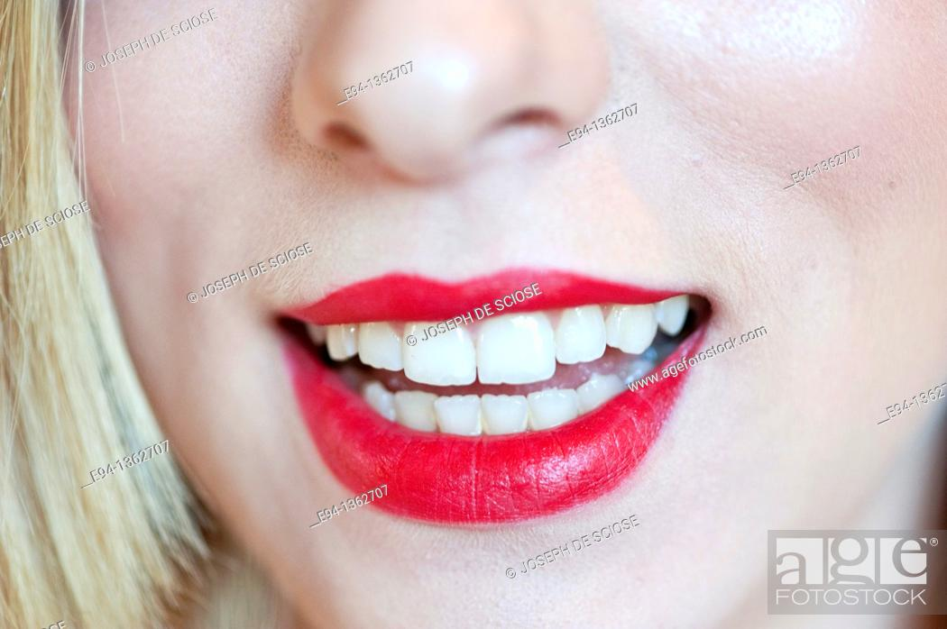 Stock Photo: Close up of red lips and mouth of a young woman.