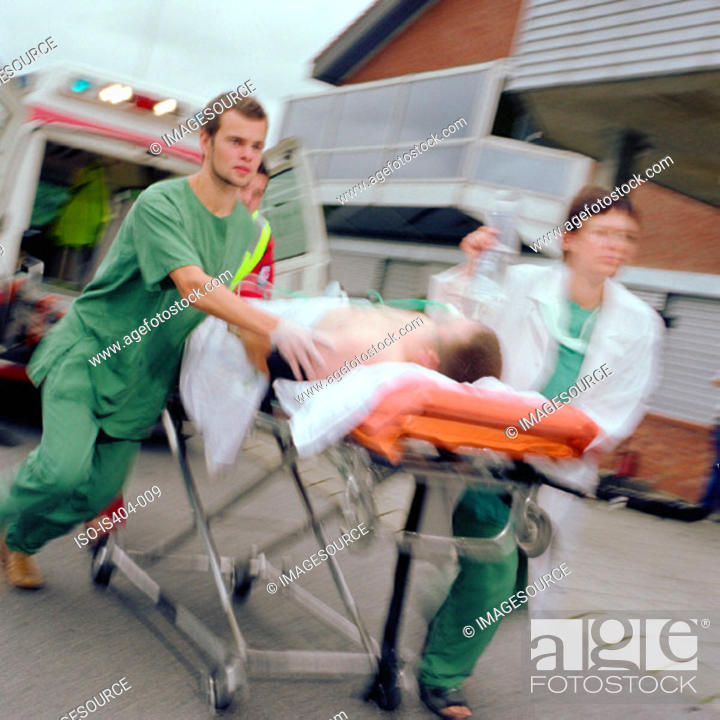 Stock Photo: Ambulance staff with patient.