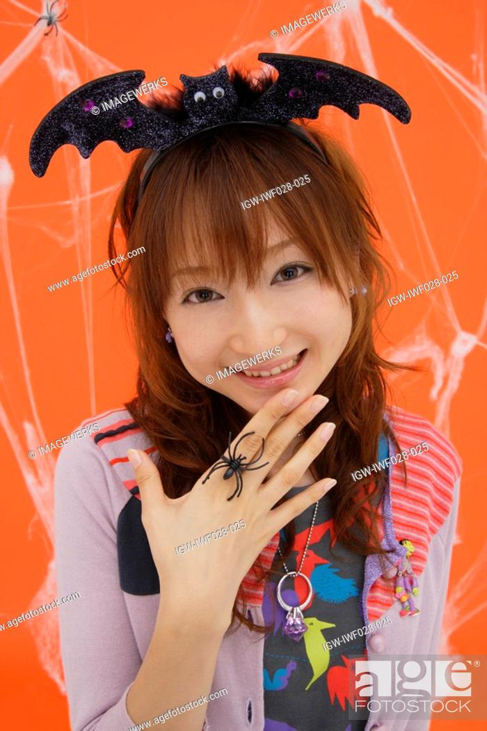Stock Photo: Close-up of teenage girl wearing a headdress.