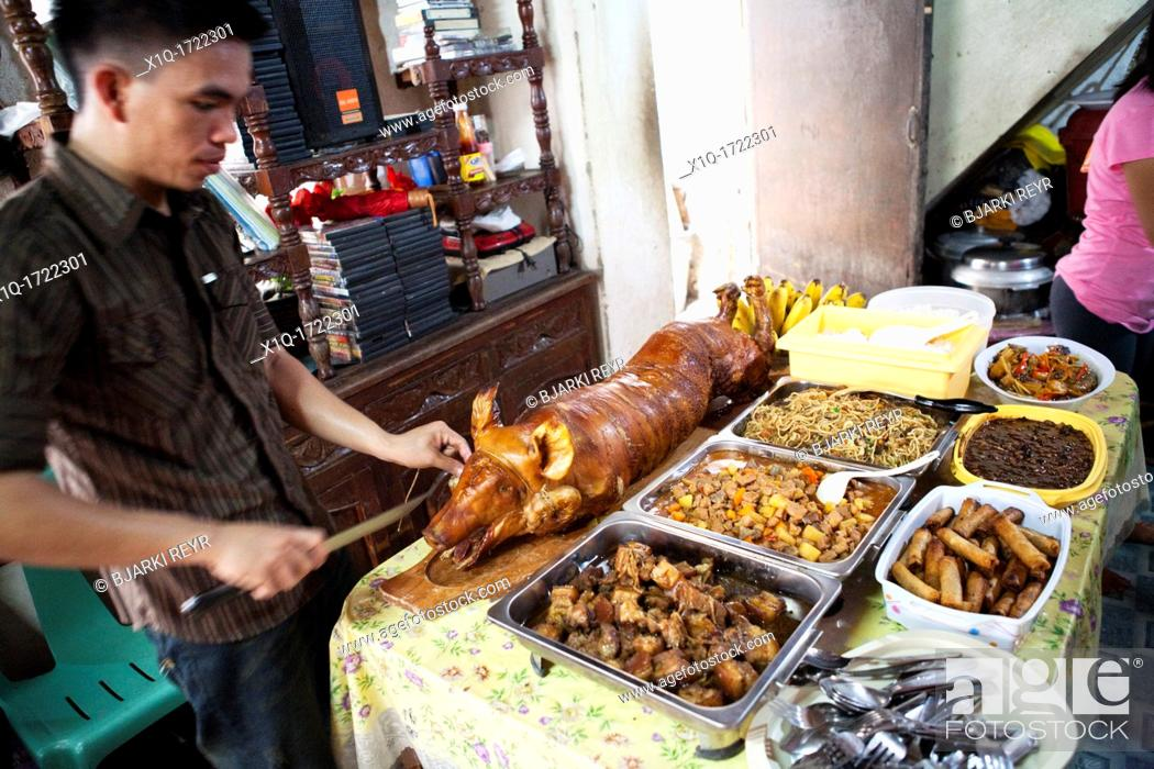 Imagen: Traditional food on offer during a baptism party at a filipino family house  Lapu-Lapu City, Metro Cebu, Mactan Island, Visayas, Philippines.