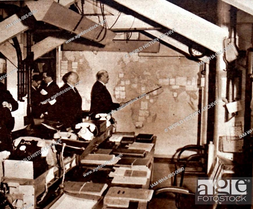 Stock Photo: Photograph of Hastings Ismay, 1st Baron Ismay (1887-1965) a British Indian Army officer and diplomat, in the war cabinet under-ground map room.