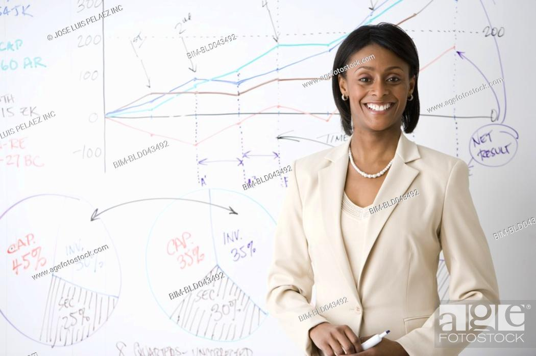 Stock Photo: African American businesswoman giving presentation.