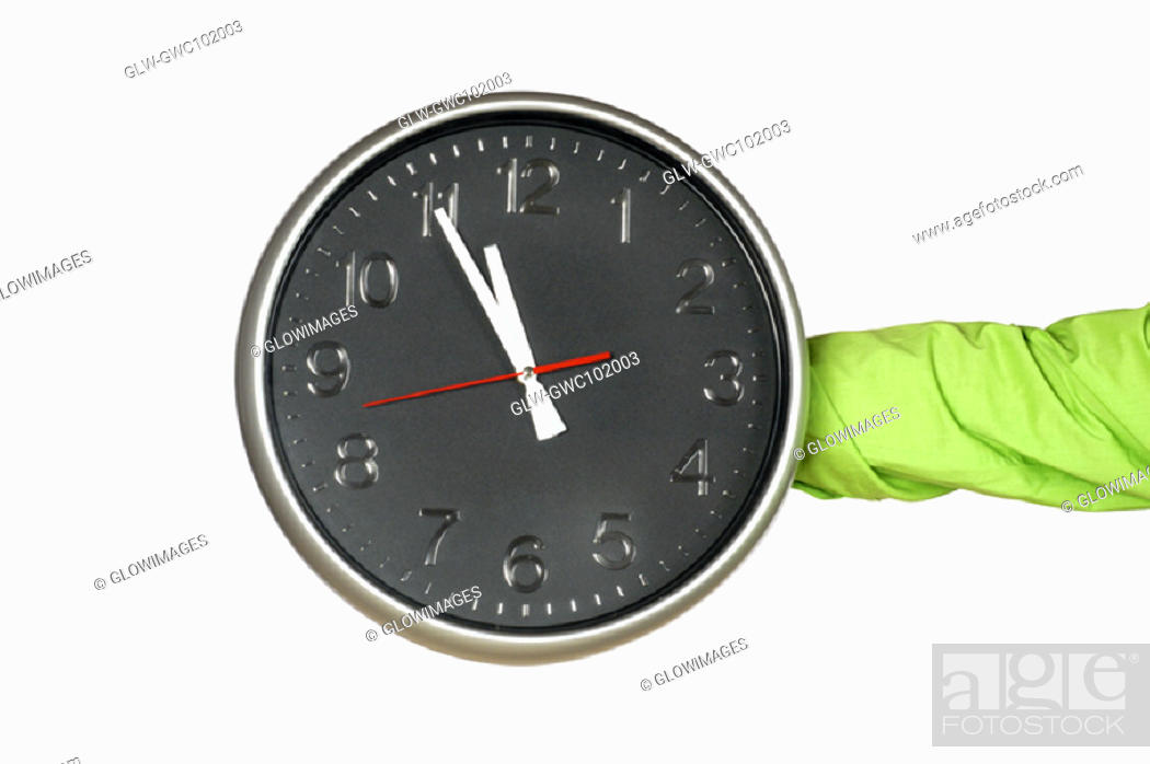 Stock Photo: Close-up of a person's hand holding a clock.