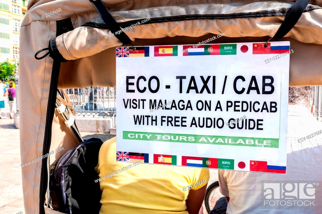 Stock Photo: Bicycle-taxi with sign and passengers in the histo.