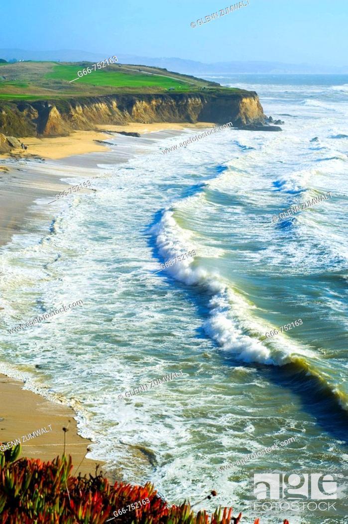 Stock Photo: Golfers on the corse along the Pacific Ocean near Half Moon Bay, California, USA.