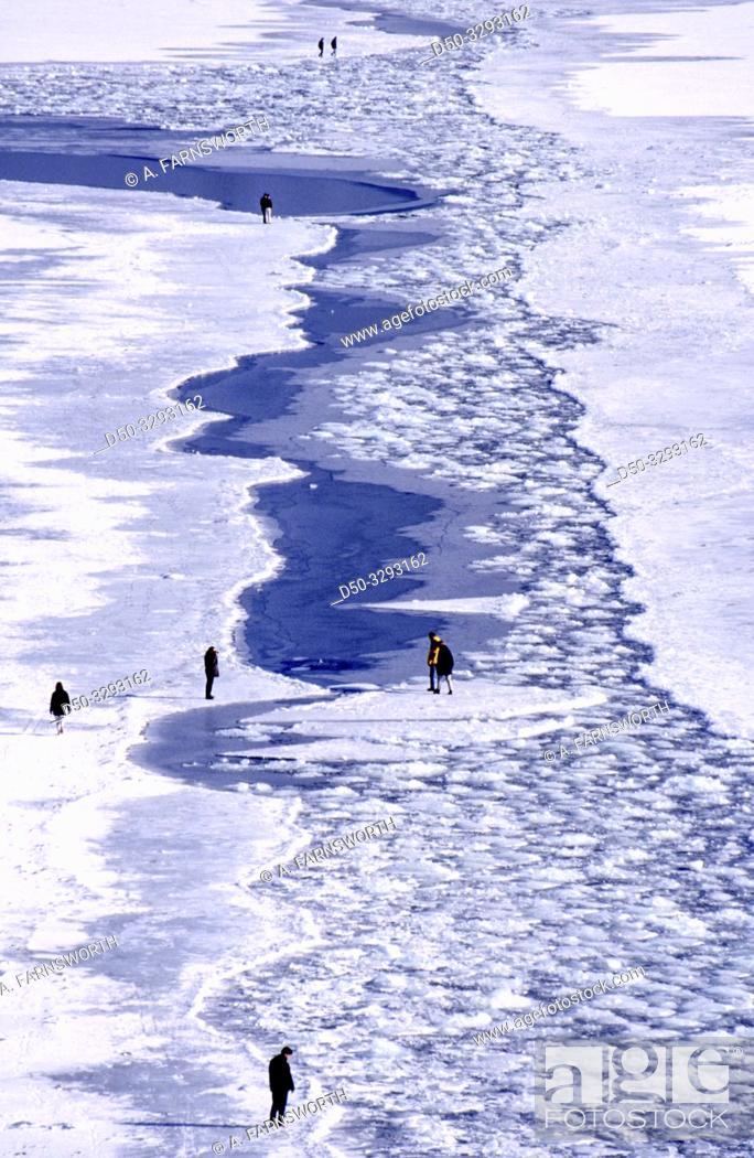 Stock Photo: STOCKHOLM SWEDEN People traversing channel on ice flows. Danger.