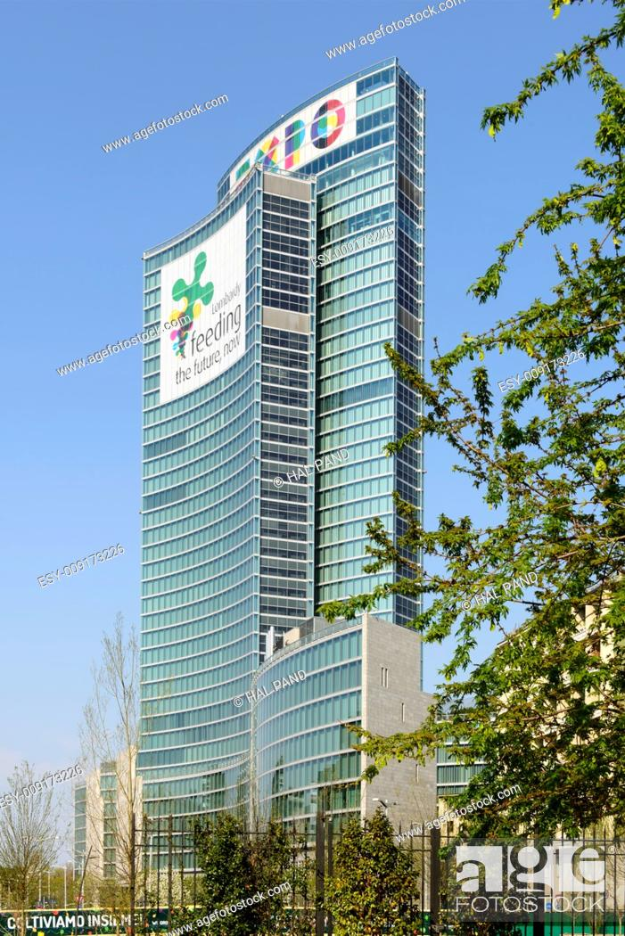 Stock Photo: MILAN, ITALY - APRIL 11: view of the building of Regione Lombardia with banners advertising the EXPO 2015 on its facade, shot on april 11 2015 Milan, Italy.