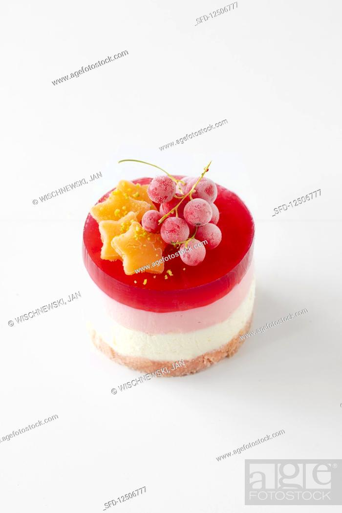 Stock Photo: Cream cheese and redcurrant tartlet with a pink sponge finger base.