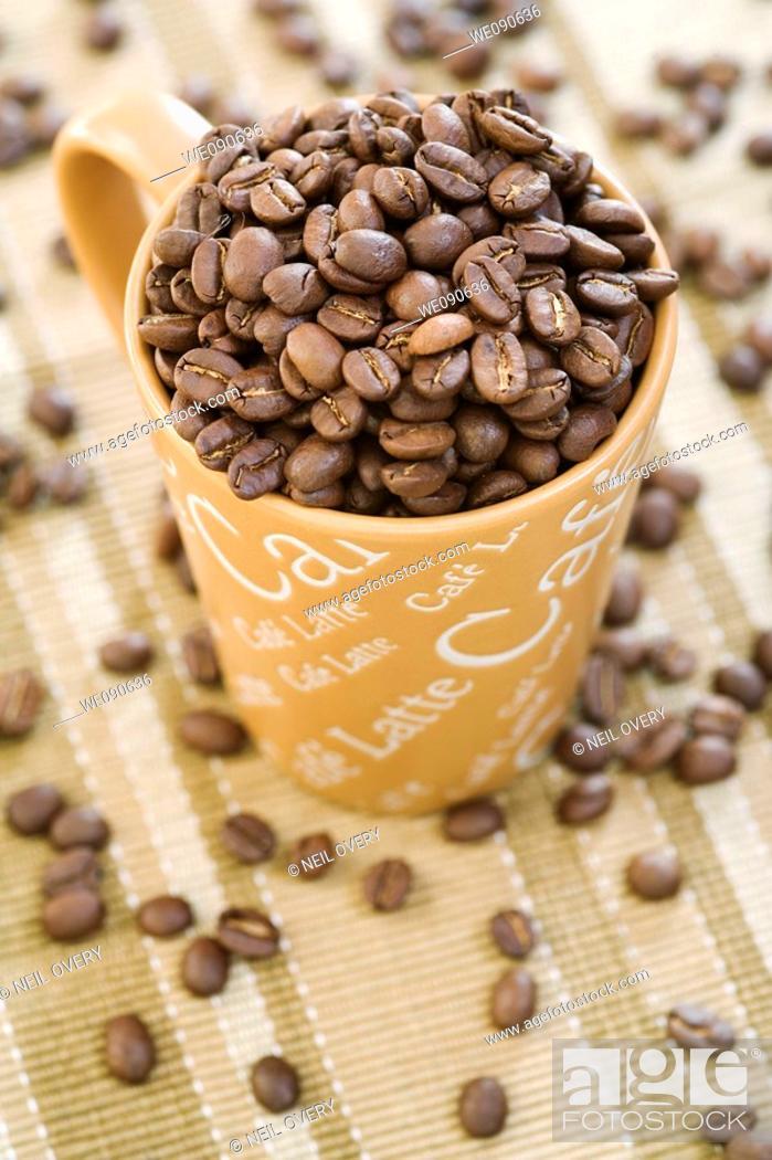 Stock Photo: Coffee beans in mug.