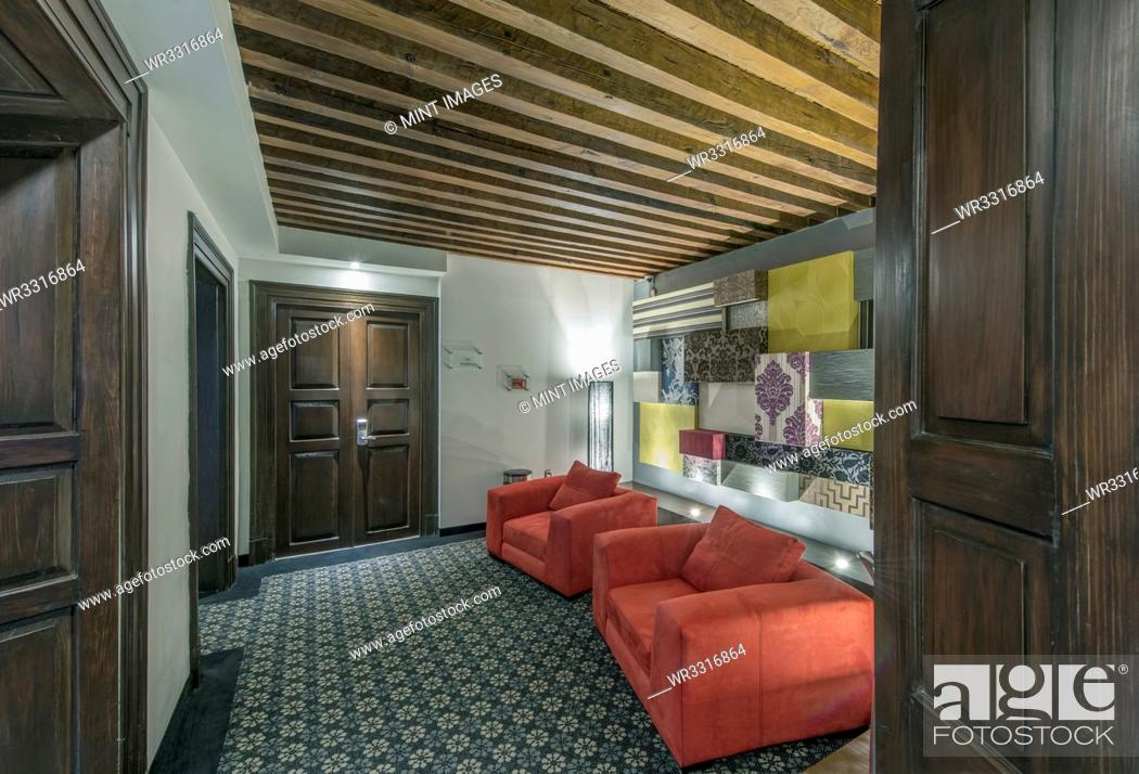 Imagen: Sofas and art in modern hotel room.