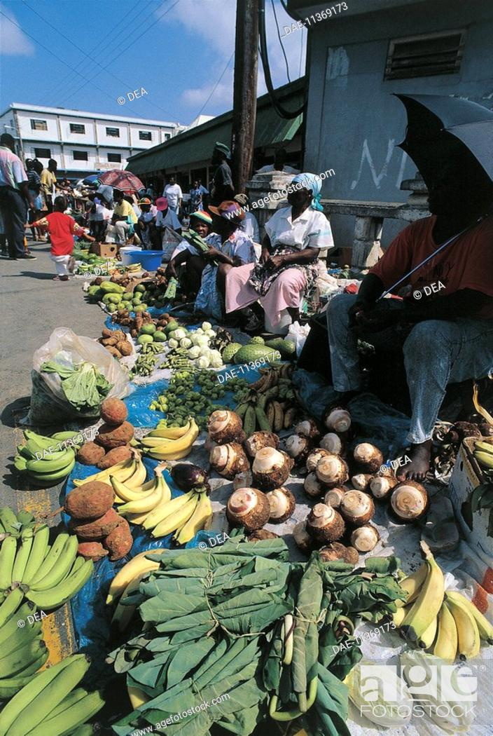 Stock Photo: Group of people in a fruit and vegetable market, St. Kitts And Nevis, Lesser Antilles.