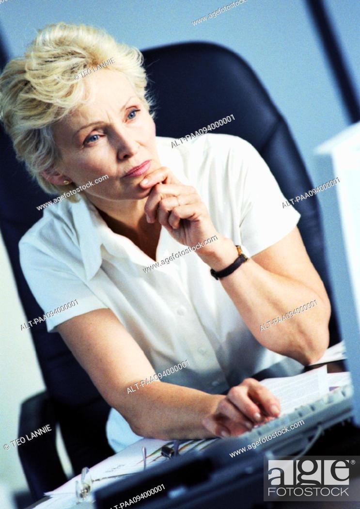 Stock Photo: Businesswoman working on computer.
