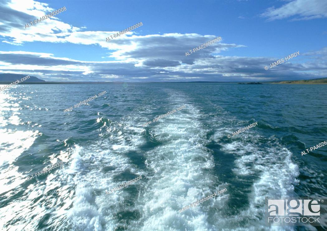 Stock Photo: Chile, Patagonia, Strait of Magellan, wake in ocean, clouds on the horizon.