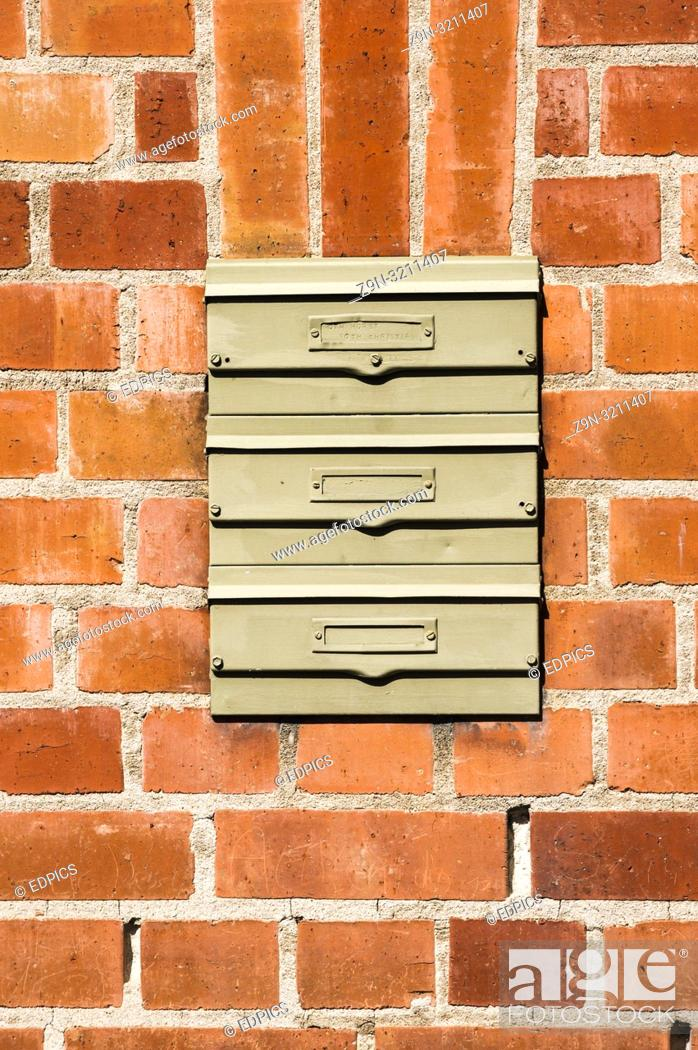 Imagen: brick wall with three letterboxes without names, heilbronn, baden-wuerttemberg, germany.