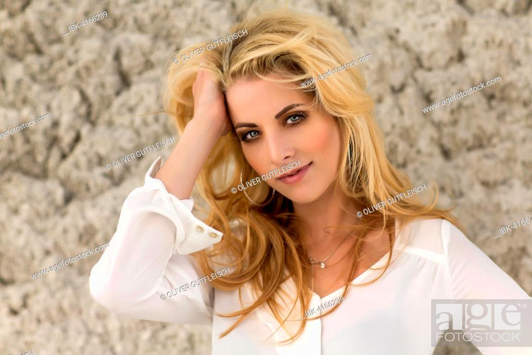 Stock Photo: Young woman, blonde, posing in white blouse, fashion, lifestyle, portrait, photo shooting.