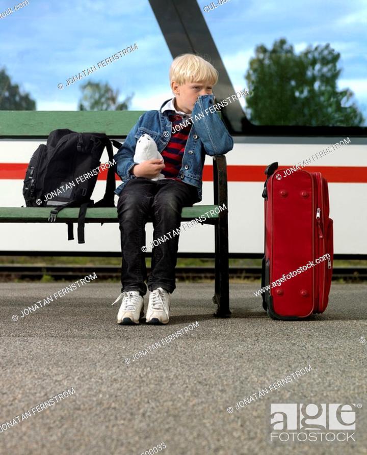 Stock Photo: Boy waiting on train station.