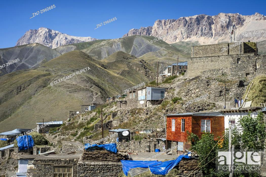 Stock Photo: Daily life in the highest village of Azerbaijan. Houses on the top of Khinalig village, Quba region, Azerbaijan. Khinalig is an ancient village deep in the.