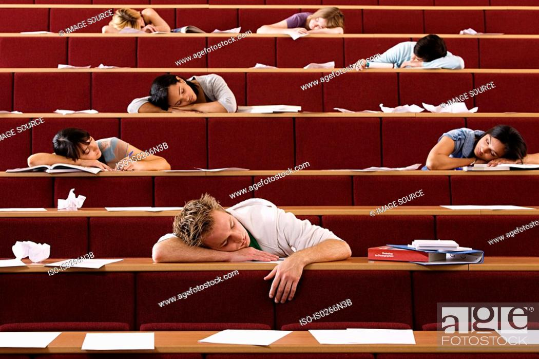 Stock Photo: Students sleeping in lecture theatre.