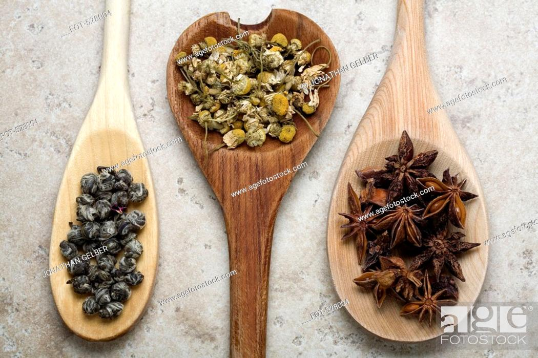 Stock Photo: Herbs and spices on wooden spoons.