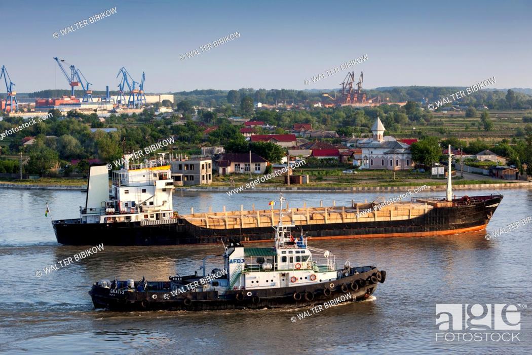 Stock Photo: Romania, Danube River Delta, Tulcea, elevated view of freighter on the Danube River, dawn.