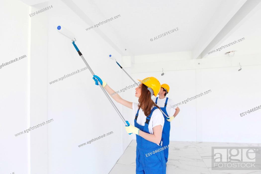 Stock Photo: workmen painting wall.