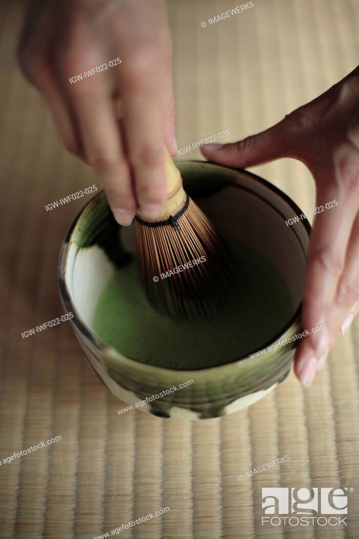 Stock Photo: View of a person grinding with a pestle.