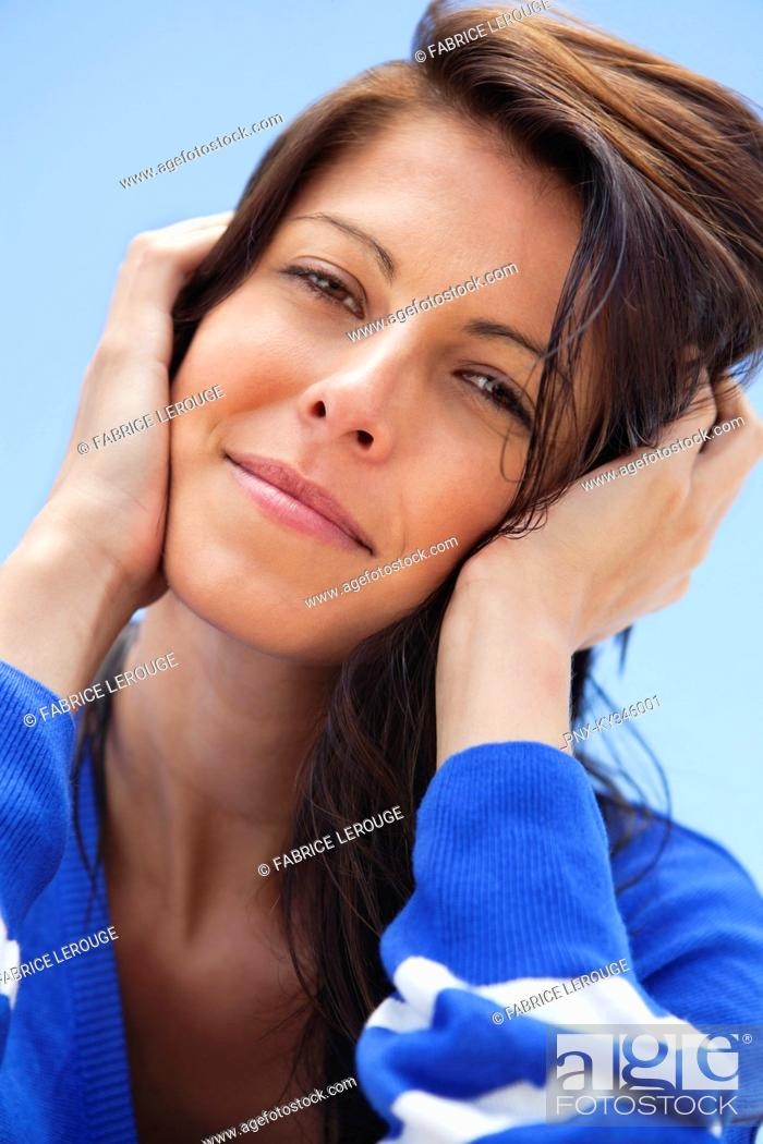 Stock Photo: Close-up of a woman day dreaming.