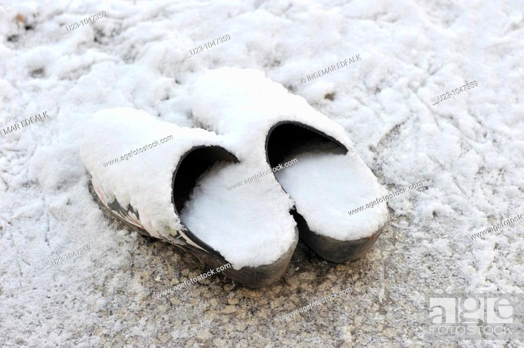 Stock Photo: A pair of clogs covered with snow.