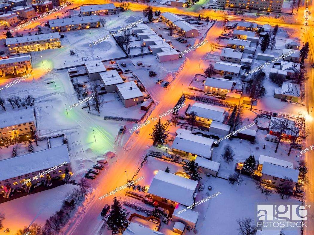 Stock Photo: Aerial view- Street and homes in the winter, Akureyri, Iceland. This image is shot using a drone.