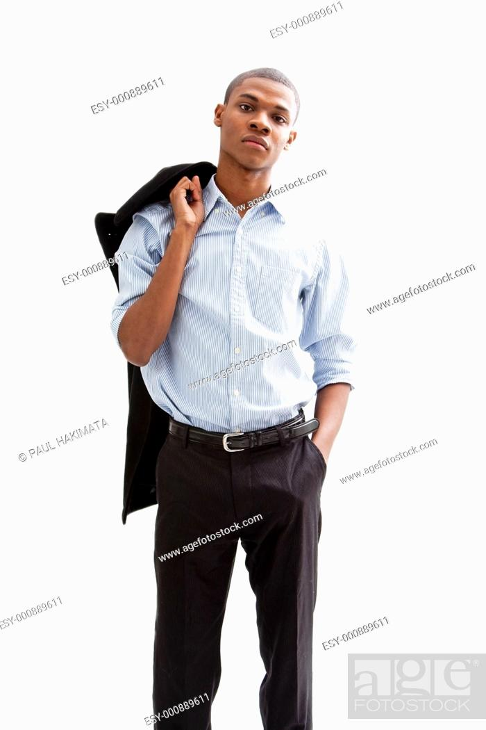 Stock Photo: Young African business man standing relaxed and secure with hand in pocket and jacket over shoulder, isolated.