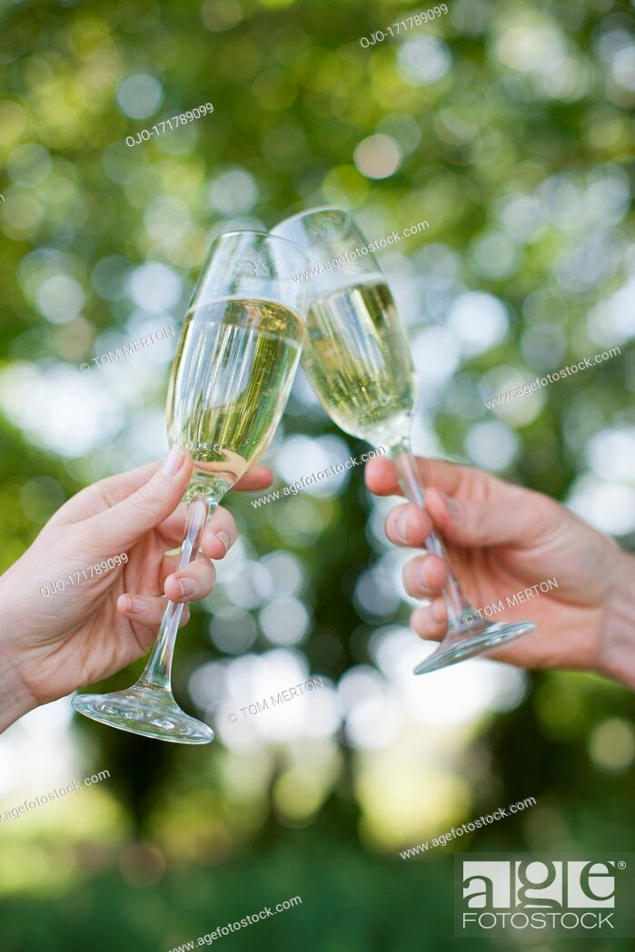 Stock Photo: Couple drinking Champagne and toasting.