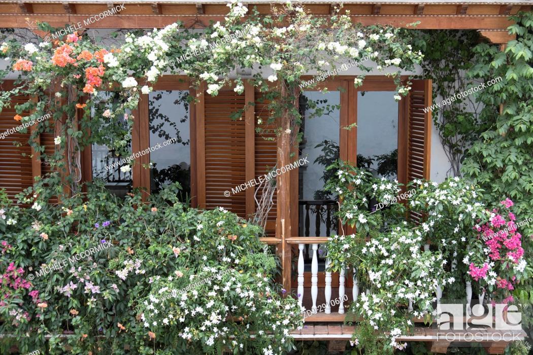 Stock Photo: A flower-bedecked balcony in Cartagena.
