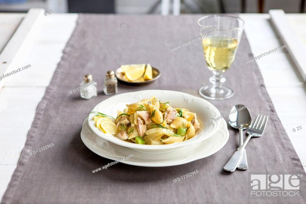 Stock Photo: Pasta shells with tarragon and fennel served with trout in anise sauce.
