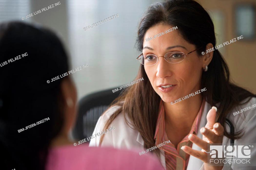 Stock Photo: Female doctor talking to a patient.
