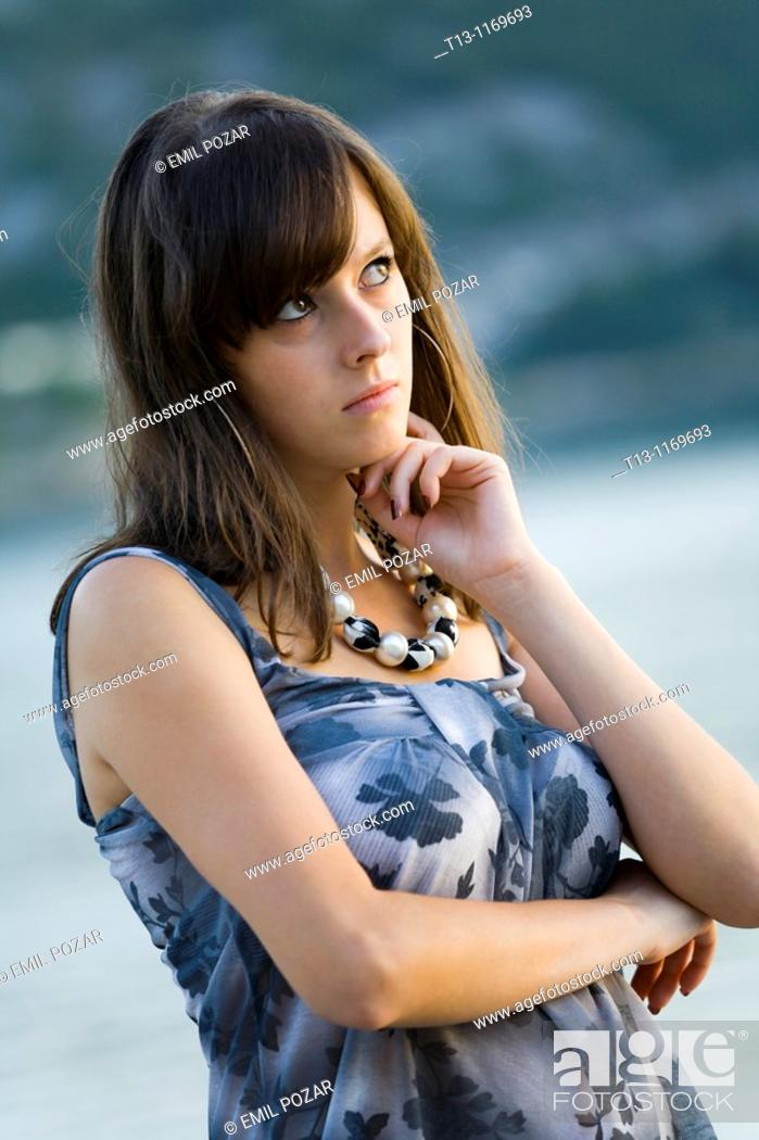 Stock Photo: Young woman lonesome.