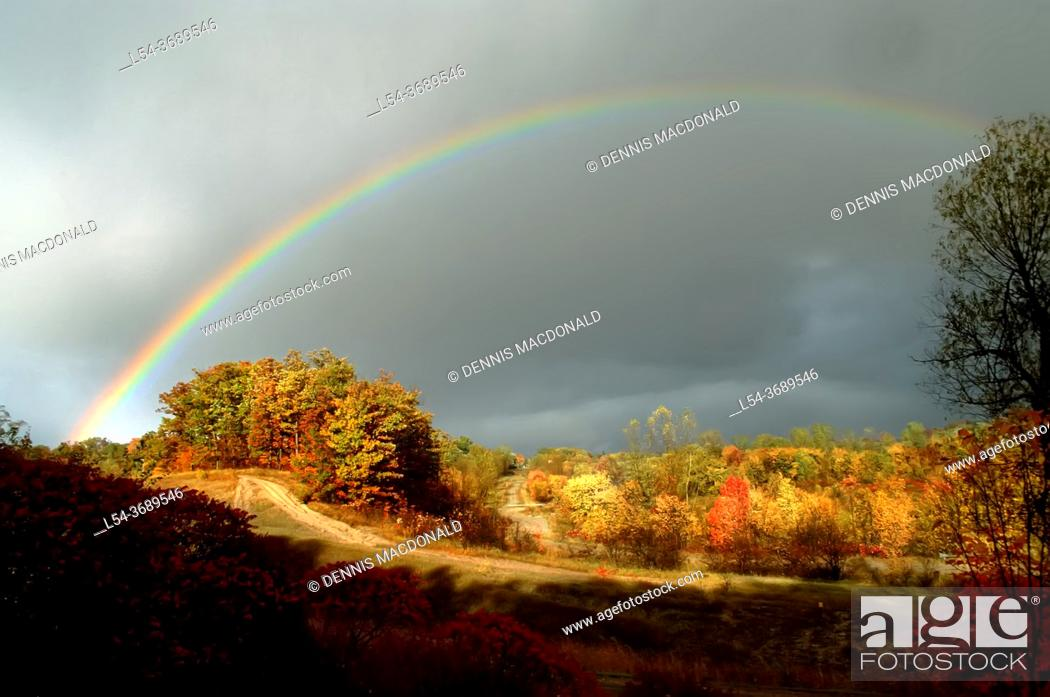 Stock Photo: Rainbow during fall colors Michigan.