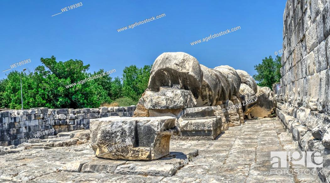 Stock Photo: Column drums fallen by an earthquake, Temple of Apollo, Didyma, Turkey, on a sunny summer day.