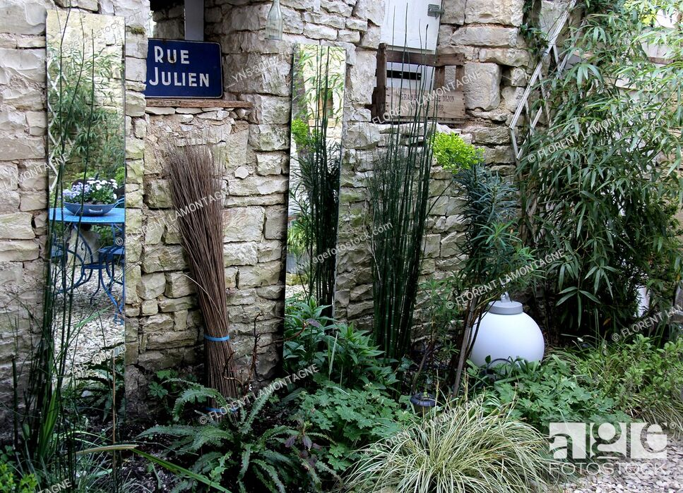 Stock Photo: Small bric a brac garden with shadow plants and mirrors to gain light and space.