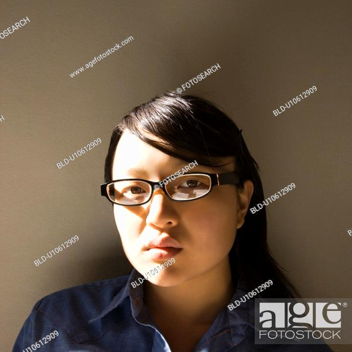 Stock Photo: Woman wearing eyeglasses.
