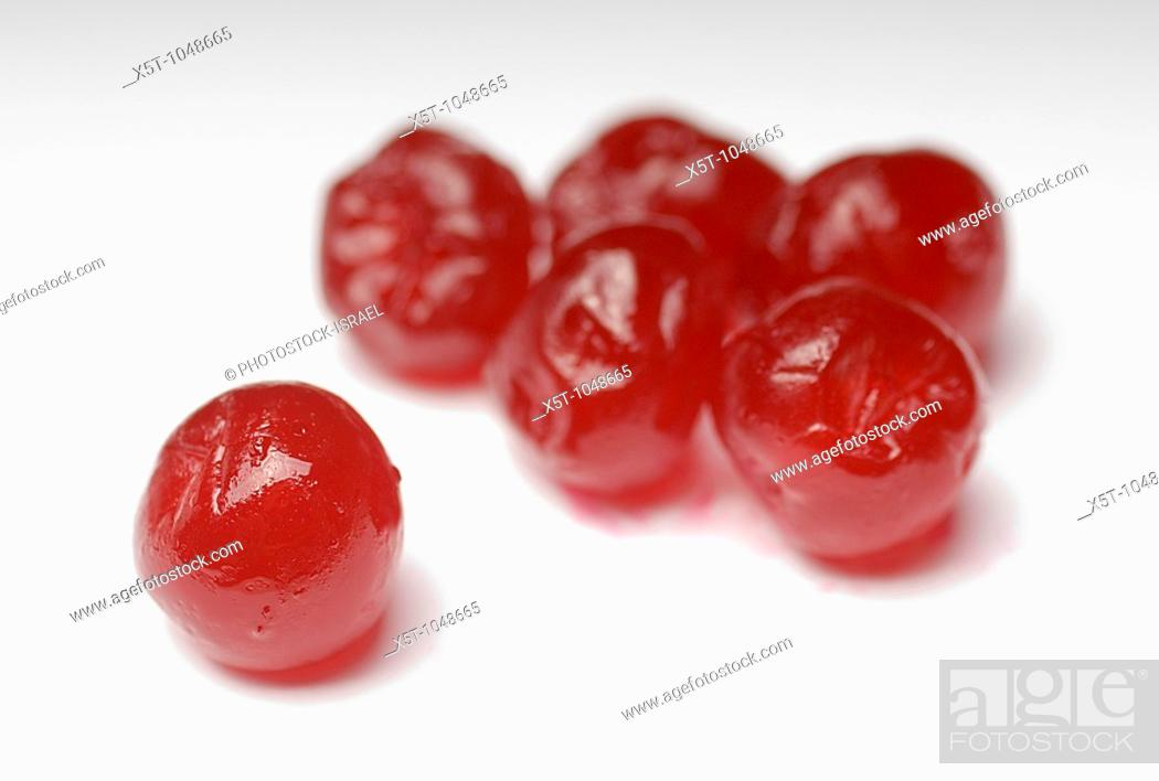 Stock Photo: Red Sugared Cherries on white background.